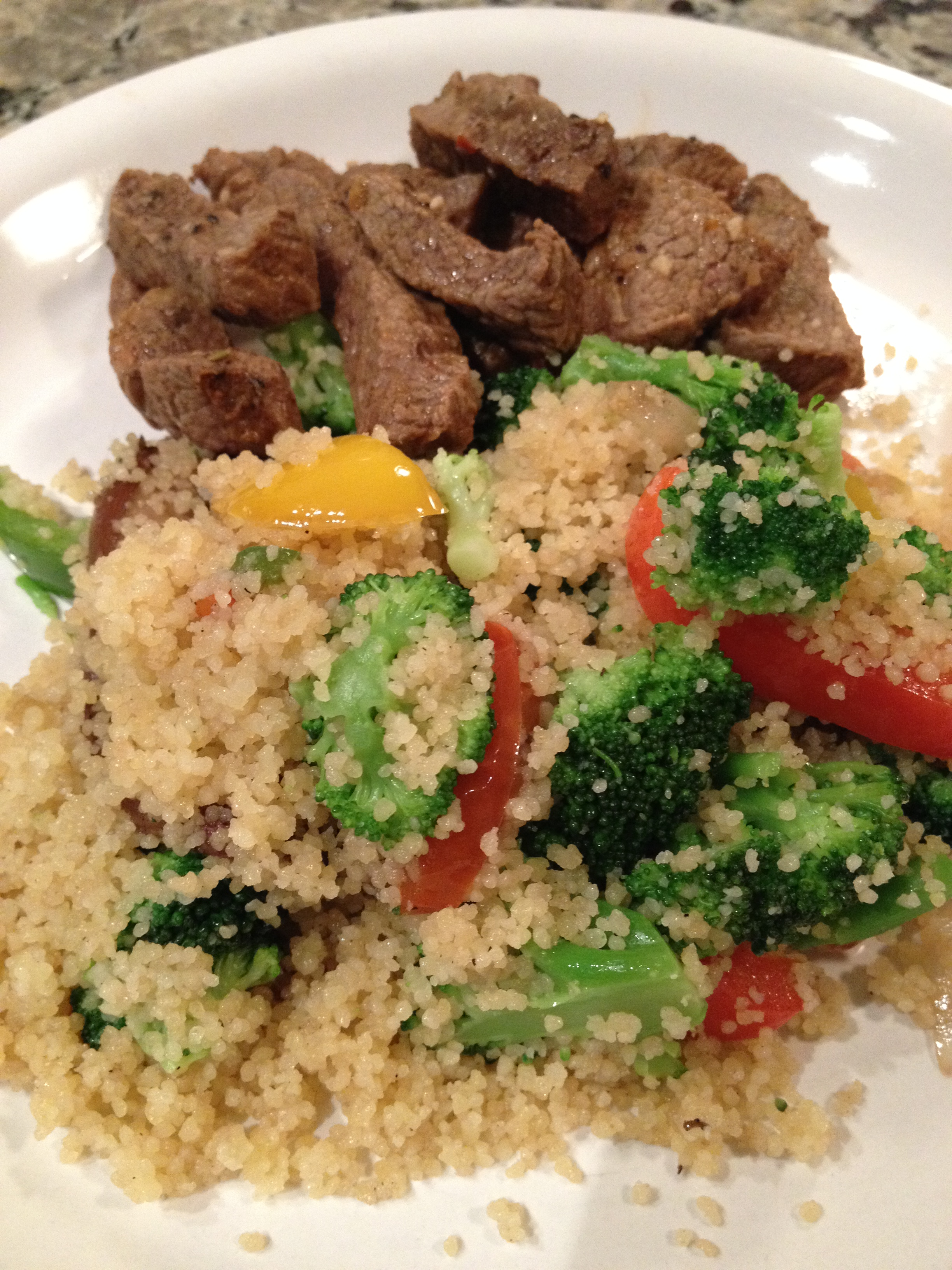 Toss in some steamable couscous (Central MArket - $2), sliced bella mushrooms, onions, peppers and sirloin. What a COMBO!